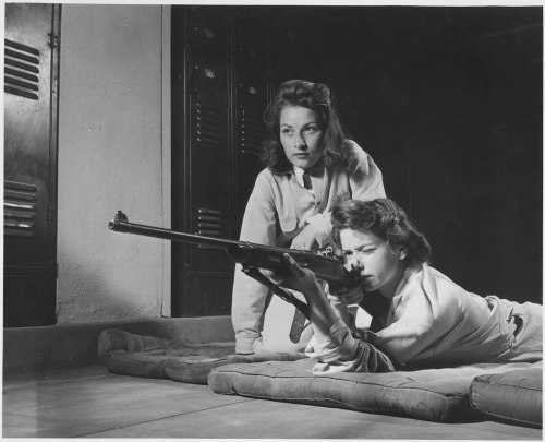 bygoneamericana:  1942. Training in marksmanship helps girls at Roosevelt High School in Los Angeles, CA develop into responsible women. Part of Victory Corps activities there, rifle practice encourages girls to be accurate in handling firearms.