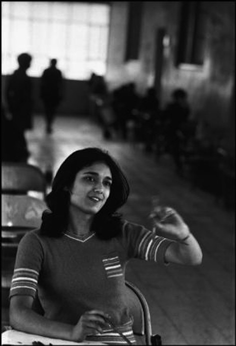 IRAN, 1971. Tehran. A female student sits for university entrance exam.  ©Abbas