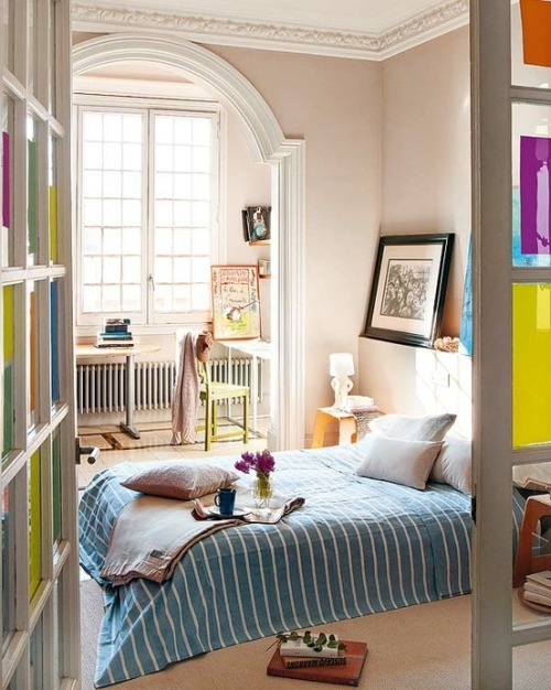 Colorful and cozy, with french windows and a home office in a nook. And tea.