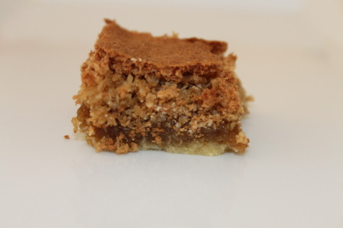 "the-mode-de-vie:  Dream Bar/Slice  This is such a super easy recipe to just whip up when one is either expecting guests or you are just feeling like baking something. Plus it is super tasty and doesn't require that many ingredients, it all makes for a perfect recipe! Ingredients: 1 cup of plain flour  1 tablespoon of brown sugar  125 grams of butter 1 and a half cups of brown sugar  1/2 teaspoons of vanilla essence  1 cup of dessicated coconut  1/2 teaspoons of baking powder  2 eggs Method   Blend the flour with the butter and the 1 tablespoon of brown sugar. Pack this mixture firmly into a greased 8"" square pan (any square pan is fine) Bake in a moderate oven (180°C, I put it on 160°C as it is a fan forced oven) for 15 minutes  Beat the eggs thoroughly, add the remaining brown sugar, vanilla essence, dessicated coconut , baking powder and mix well. Spread evenly over the the baked biscuit crust  Return to the oven and bake for a further 30 minutes or until the mixture is no longer moving in the pan (it is normal when you do the knife test to see if it is cooked that it comes out a bit runny, this is fine it is a very wet mixture) You can eat it warm or let it cool and then cut into a desirable portion for you! Enjoy!"