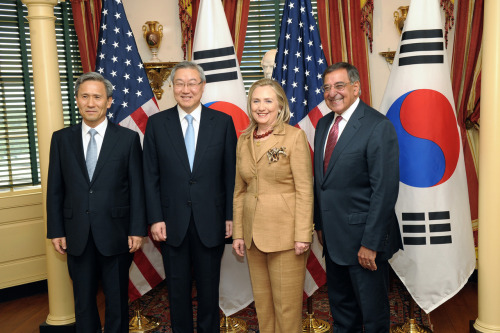 Secretary Clinton poses fr a photo with  Secretary of Defense Leon Panetta, Minister of Foreign Affairs and Trade of the Republic of Korea Kim Sung-Hwan, and Minister of National Defense of the Republic of Korea Kwan-Jin after the U.S.-Korea ministerial dialogue 2+2 meeting at the U.S. Department of State in Washington, D.C. on June 14, 2012. [State Department photo/ Public Domain]