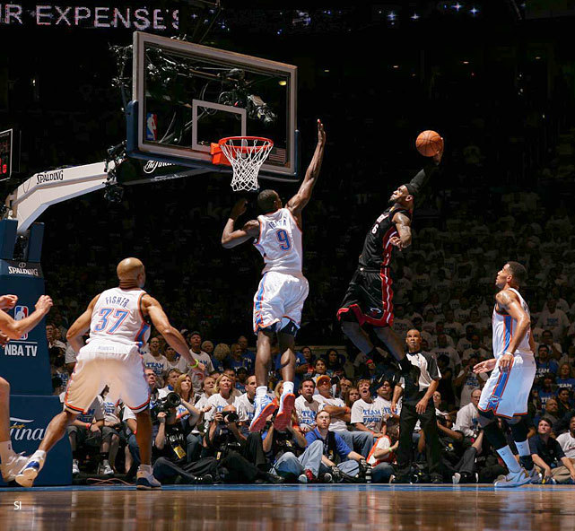 LeBron James skies for a dunk on Serge Ibaka during Thursday's Heat-Thunder game. Although Ibaka ended up blocking this attempt, James and Miami got the last laugh with a 100-96 win to tie up the NBA Finals at 1-1. Game 3 is Sunday in Miami. (Greg Nelson/SI) ROSENBERG: Heat prove to be stronger, grittier team in Game 2THOMSEN: LeBron delivers with clutch play in fourth quarterGALLERY: SI's Best Photos From Game 2