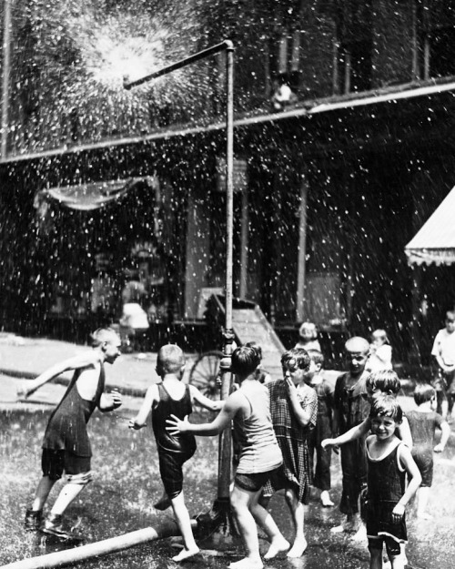 Sprinklers on a hot New York day 1932