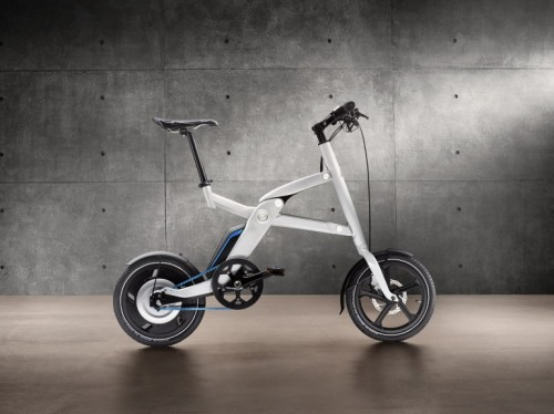 BMW unveils i Pedelec bicycle concept BMW has further strengthened its commitment to an electric mobility future by announcing the opening of its first i Store on July 25. To celebrate the event, the German auto giant has developed a new folding pedal-electric bike called the i Pedelec. Like the Voltitude, the new bike can be rolled along when folded to make getting on and off trains or buses, or in and out of elevators, a little less troublesome, and benefits from a geared electric hub motor, high performance batteries and disc braking at the front and rear. BMW also says that two folded i Pedelec bikes can be comfortably squeezed into the trunk space of its forthcoming i3 EV, and that their batteries can be charged while in there