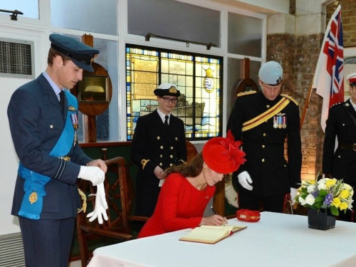 Prince Harry of Wales with Duke & Duchess of Cambridge signing the visitors book at HMS President on Jubilee Day -medwayrnr