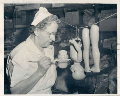 "calumet412:  A ""nurse"" at the doll hospital, 4256 Lincoln Ave, 1952, Chicago."