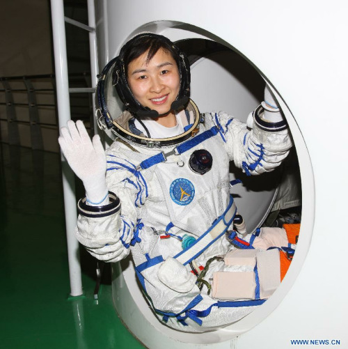 This undated photo shows Liu Yang, 34, one of the three taikonauts who will be carried by the Shenzhou-9 spaceship for China's first manned space docking mission with the orbiting Tiangong-1 space lab module. Liu was selected as a taikonaut in 2010. (Xinhua/Qin Xian'an)