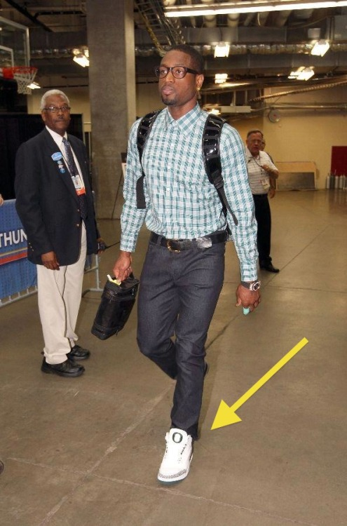 "Straight Urkel from the ankles-up. Alright D-Wade, if you are going to rep the O, figure out the rest of your ""swag,"" because the non-prescription frames matched with the tieless top-button look is awful. Do you even have anything in that backpack?At least it's not buckled across his chest like Durant's corny ass. Figure.It.Out."