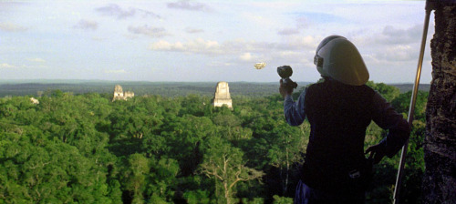 Remember this scene from the first Star Wars movie? It was shot at Tikal, Guatemala—those are the ruined temples poking above the canopy. So I was at Tikal for a few days, and I was staying at a campground right outside the ruins. While hanging out, some other campers showed me a barely-there forest trail that led to a huge tree that had a series of ladders and platforms built up it (the ladders and platforms were made of forest saplings tied together, not finished wood or anything…). It was rickety and scary, but pretty cool being up that high in the rain forest. One of the nights I was there, I and a couple other people came back and slept in our sleeping bags on the platforms—it was nice, up above the mosquitoes. Anyway, I always wondered if that rig was a remnant of the filming. I've compared the above screenshot with the locations of the temples in Google Earth, and I don't think so…it seems like my estimated filming point is quite a ways from the campground. But who knows…the forest track may have been longer than I remember, and we are talking about 20 years ago…