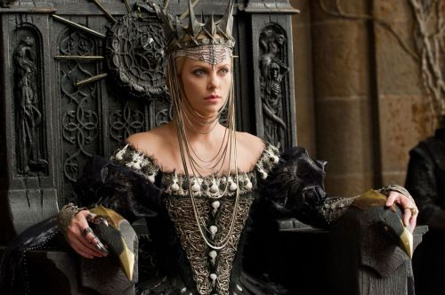 Snow White and the Huntsman - Charlize Theron as the Evil Queen wearing an elaborate bone-themed dress. The bodice is embellished with bird skulls, tiny feathers and snake-like gold metal appliqués. The costumes were designed by Colleen Atwood.
