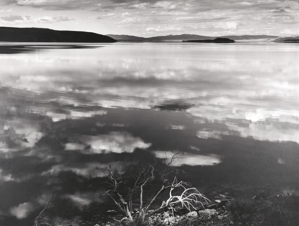 "Exhibition reveals the more fluid side of Ansel Adams  The photography of Ansel Adams is so sturdily composed, so enduringly right that it can feel like the aesthetic equivalent of granite. (""Reflections at Mono Lake, California,"" 1948.)"