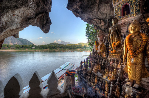 Buddha Cave by JRaptor on Flickr. Buddha statues in lower Pak Ou Cave on the Mekong River north of Luang Prabang, Laos.