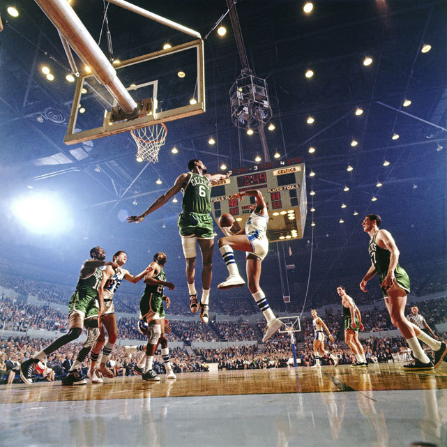 Bill Russell guards the lane against an Elgin Baylor drive during Game 4 of the 1966 NBA Finals between the Lakers and Celtics. Boston would go onto win the title in seven games, capturing their eighth straight championship and ninth in franchise history. (Walter Iooss Jr./SI)   GALLERY: Rare Photos of Bill Russell | Iconic Lakers | Iconic CelticsSI VAULT: Bill Russell wanted, and got, a new pair of shoes (4.11.66)