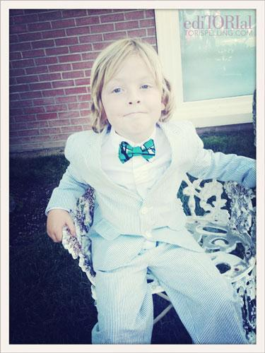 "Tori Spelling posted this picture of her son Liam at a recent party in honor of Stella McDermott, age four.   ""Liam insisted he wear a suit and bowtie for Stella's party. He takes fashion and his role as big brother very seriously! Love him in this summer seersucker and silk bowtie made especially for him.""  Between the bold pattern and that smug smile, I have a sneaking suspicious Liam is going to grow up to be the next Chuck Bass. Or just the next Tori Spelling. I don't know which is worse."