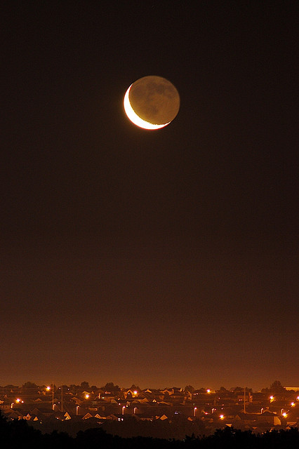 Crescent Moon Over Lincoln Nebraska by Nebraska Farm Boy on Flickr.
