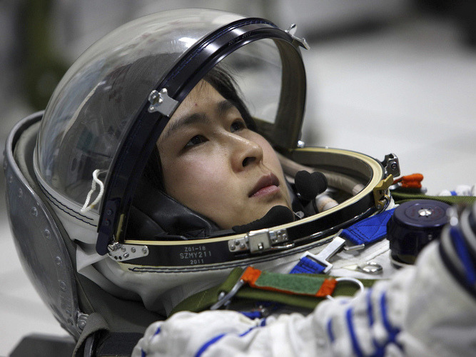 lookhigh:  She's A Taikonaut - China Is Sending Its First Woman Into Space She's not an astronaut or cosmonaut - Liu Yang is a taikonaut, and tomorrow she's scheduled to become China's first woman to venture into space. She's one of a three member team scheduled to lift off aboard the Shenzhou-9, accompanied by Jing Haipeng and Liu Wang. Chinese media featured glowing reports about Liu's prowess, noting she's a Chinese air force major and a military pilot with a cool head. According to China Daily, in 2003, birds struck the engine of a plane Liu was piloting. She lost the right engine but stabilized the aircraft and made a safe emergency landing. Watch out, Sully. (NPR)