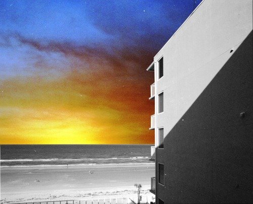 sfmoma:  SUBMISSION: 2 6x6 negatives. Sky from Phx, AZ. Building is the Holiday Inn Daytona Beach, Fl