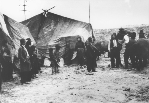 Roma (Gypsies) in front of their tents. Romania, 1936-1940