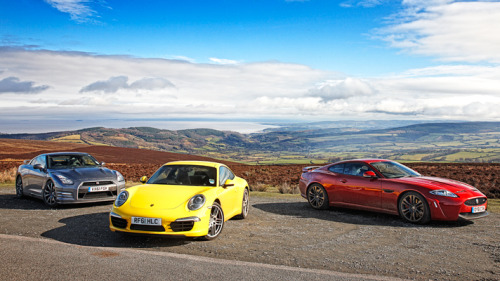 topgear:  Top Gear Mag pits the Nissan GT-R vs Porsche 911 vs Jaguar XKR-S Click through for a sports car comparison full of pretty pictures and lots of words.