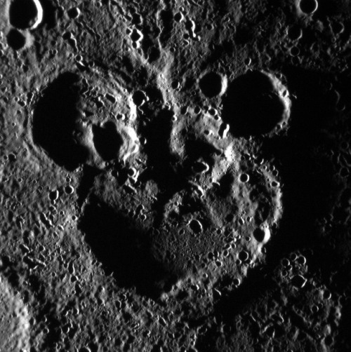 "Mickey Mouse Spotted on Mercury! by NASA Goddard Photo and Video on Flickr.Via Flickr: NASA image acquired: June 03, 2012 This scene is to the northwest of the recently named crater Magritte, in Mercury's south. The image is not map projected; the larger crater actually sits to the north of the two smaller ones. The shadowing helps define the striking ""Mickey Mouse"" resemblance, created by the accumulation of craters over Mercury's long geologic history. This image was acquired as part of MDIS's high-incidence-angle base map. The high-incidence-angle base map is a major mapping activity in MESSENGER's extended mission and complements the surface morphology base map of MESSENGER's primary mission that was acquired under generally more moderate incidence angles. High incidence angles, achieved when the Sun is near the horizon, result in long shadows that accentuate the small-scale topography of geologic features. The high-incidence-angle base map is being acquired with an average resolution of 200 meters/pixel. The MESSENGER spacecraft is the first ever to orbit the planet Mercury, and the spacecraft's seven scientific instruments and radio science investigation are unraveling the history and evolution of the Solar System's innermost planet. Visit the Why Mercury? section of this website to learn more about the key science questions that the MESSENGER mission is addressing. During the one-year primary mission, MESSENGER acquired 88,746 images and extensive other data sets. MESSENGER is now in a yearlong extended mission, during which plans call for the acquisition of more than 80,000 additional images to support MESSENGER's science goals. Credit: NASA/Johns Hopkins University Applied Physics Laboratory/Carnegie Institution of Washington"