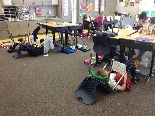 mikebyster: Here is a creative teaching idea: By turning their chairs over, each student gets their own, relaxing space to read!