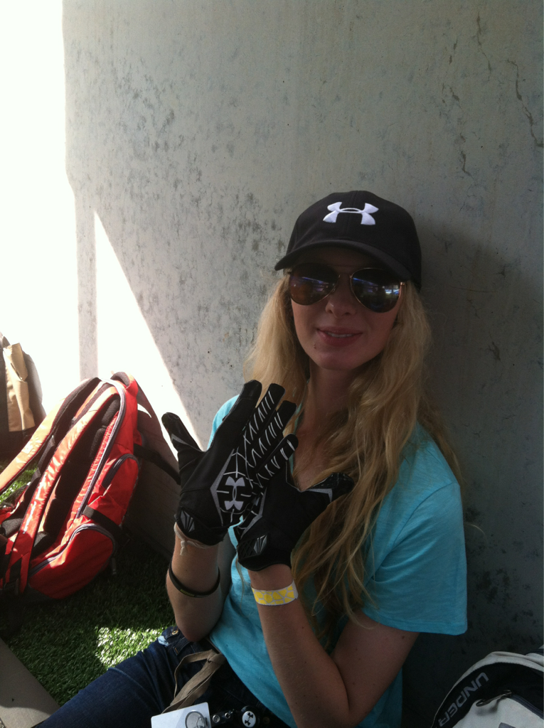 Catch of the day! Trying out the gloves at the Ravens 7-on-7 Championship game at M & T Bank Stadium.  ~Amelia for Under Armour: Ultimate Intern, Writer
