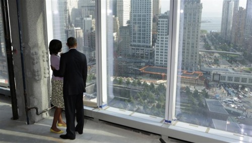 President Barack Obama and first lady Michelle Obama look down at the 9/11 Memorial while touring the One World Trade Center building which is under construction in New York.  Credit: REUTERS/Kevin Lamarque