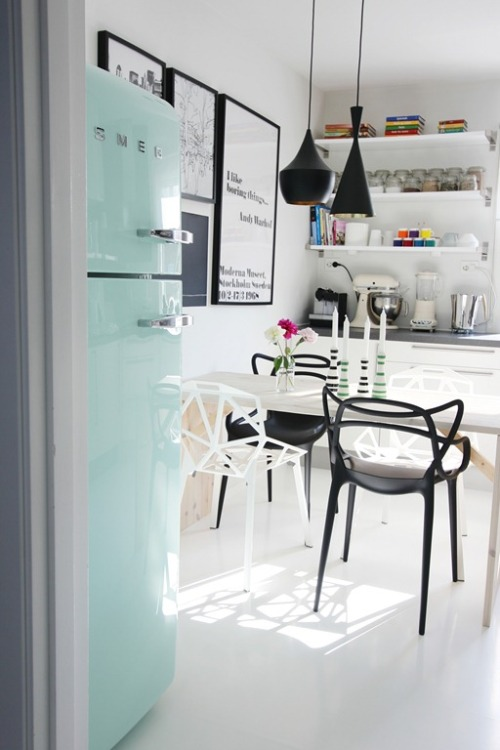 Source: Nordic Leaves Great kitchen! Perfect colour combinations. Love the Tom Dixon pendant lights, the Masters chairs, the open shleving and of course the smeg fridge! Amazing colours. Get them here, here & here.