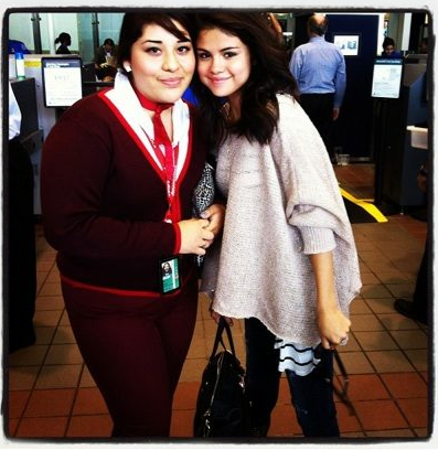 Selena Gomez with a fan