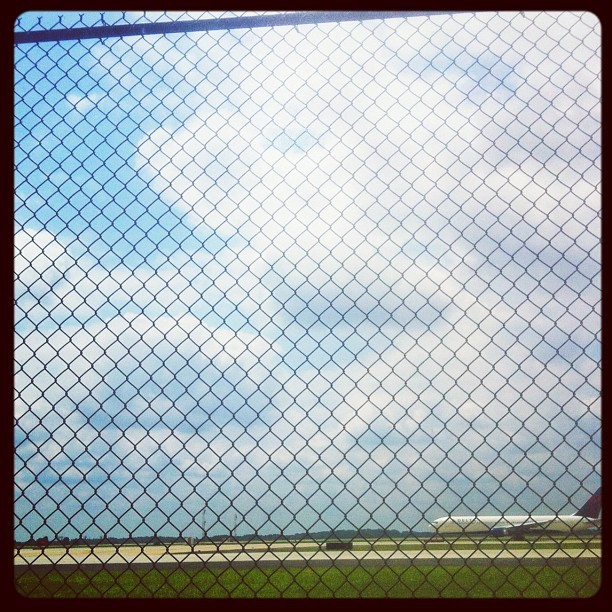 167 - ready for take-off #fence #airplane #airport #chainlink #sky #clouds #photoaday #photooftheday   (Taken with Instagram)