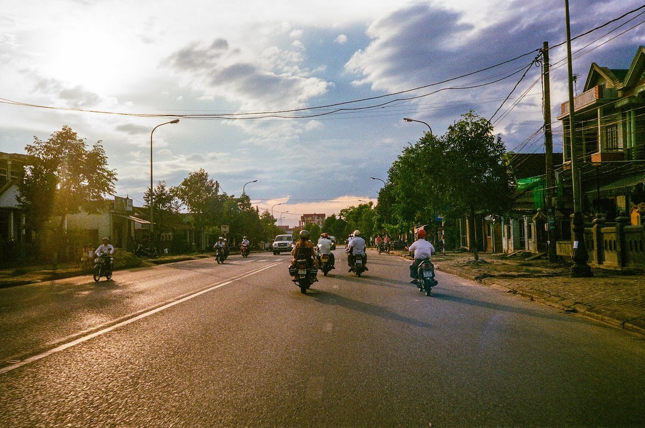 "Heading Home - Hue, Vietnam Despite the sometimes unbearable heat, there's something magical about heading home in the middle of summer. I think it has something to do with the sun's rays. The days last longer in the summer so the ""magic hour"", the time of day when the light is the best for photography is stretched out longer. As such, when you're on your way home, everything looks beautiful because it's painted by this gorgeous light. Combined with the ecstasy you get from being done with your day, the feeling is just pure bliss."