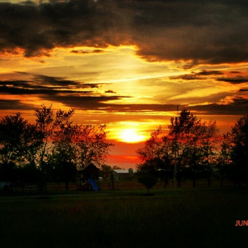 #sky #clouds #sun #sunset #trees #barn #field (Taken with Instagram)