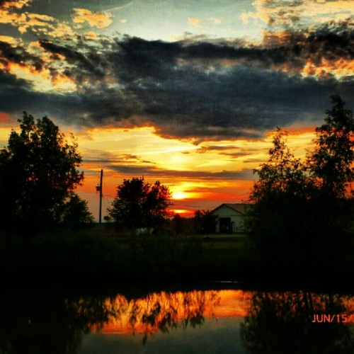 #sky #clouds #sun #sunset #hydropole #trees #barn #water #reflection  (Taken with Instagram)