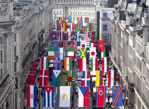 national flags going up on regent street in preparation for the olympics
