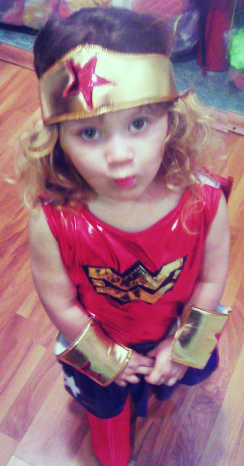caught-in-the-eye-of-the-storm:  My little sister trying on her Wonder Woman costume for her birthday party tomorrow.