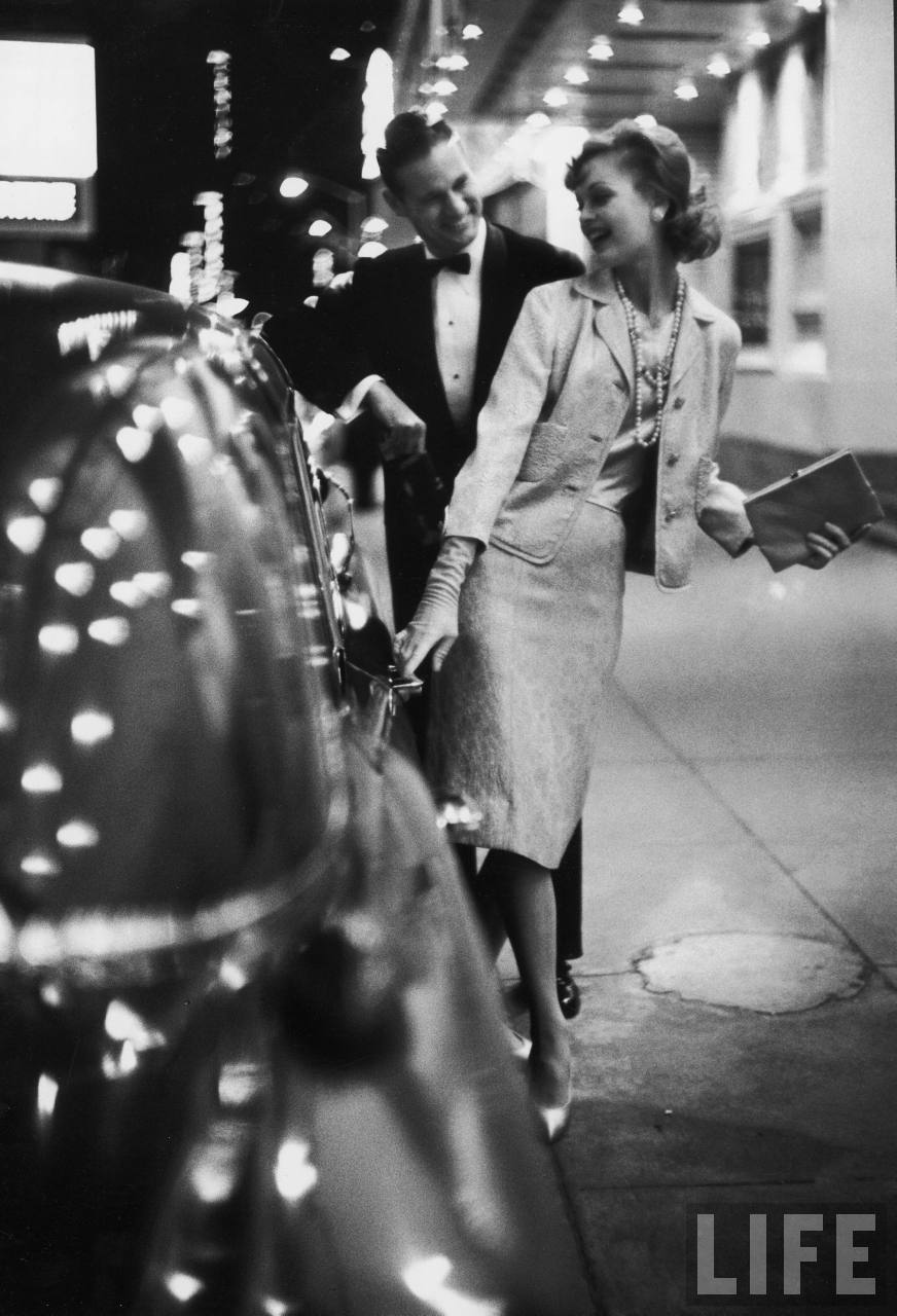 Woman wearing Daridow copy of Chanel evening suit, 1958. By Gordon Parks