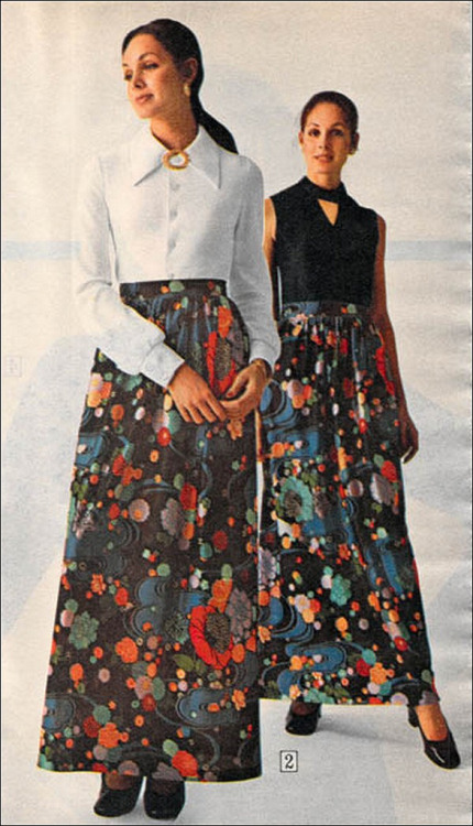 Models wearing long printed skirts for day and evening, 1972.