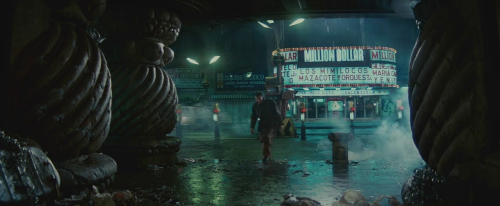 Deckard in front of the theater. Blade Runner (1982) directed by Ridley Scott, starring Harrison Ford, Rutger Hauer, Sean Young, Edward James Olmos, M. Emmet Walsh, Daryl Hannah, William Sanderson, Brion James, Joe Turkel, Joanna Cassidy, James Hong, Morgan Paull, Kevin Thompson. Based on Do Androids Dream of Electric Sheep? by Philip K. Dick.