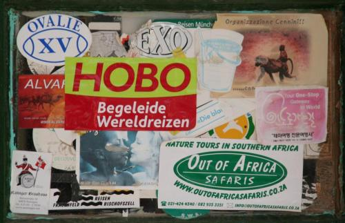 Travellers' stickers on the window of the store at Solitaire, Namibia.