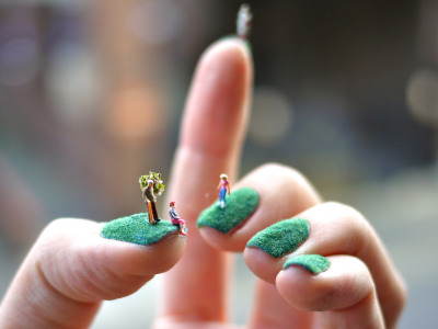 Little people play on Alice Bartlett's fingernails.