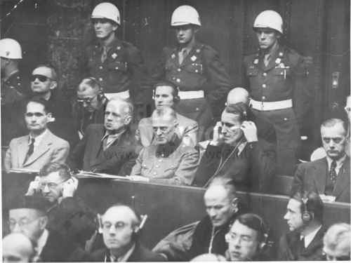 nurembergtrials:  frauvonribbentrop:  Really ALL look so freaky in that picture  Keitel's face is priceless and I think Ribbentrop is looking for something in his pocket, Hess has his usual face on, too funny !