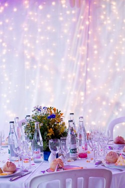 "my-big-fat-wedding-kitsch:  ""Wedding table - simple twinkle lights behind a tulle backdrop. Use colored tulle for a more playful or feminine feel."""