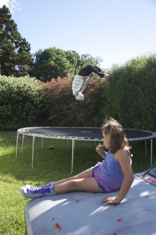 jumping on the tramp, sitting on the car. Kerikeri.