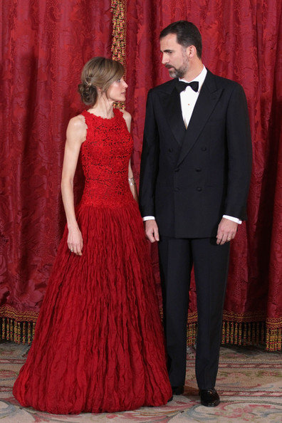 Prince Felipe and Princess Letizia wait for the Prince of Wales and the Duchess of Cornwall at the Royal Palace in Madrid.