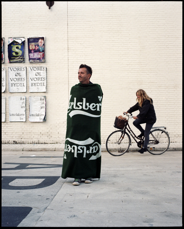 My teacher Damian Heinisch as a bottle of beer. And Anki Grøthe biking in the background. Copenhagen Photo Festival 2012.