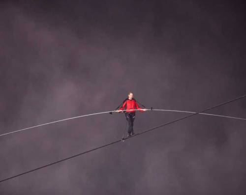 Nik Wallenda Makes History and Crosses Niagara on a Tightrope  With the aid of a long balancing pole, Wallenda carefully found his footing along the lengthy cable and maintained a laser-like focus on his task throughout.  keep reading Image: The 33-year-old tightrope walker braved strong winds and heavy spray to walk on a cable suspended about 200 feet above the biggest waterfall in North America. Zou Zheng/Xinhua Press/Corbis