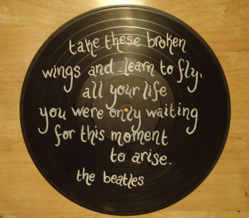 Custom ordered Beatles painted record with lyrics from Blackbird
