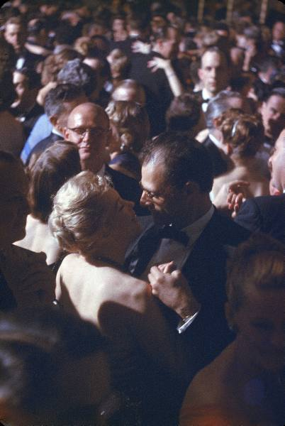 Playwright Arthur Miller dancing w. his wife, actress Marilyn Monroe, at the April in Paris Ball in the Waldorf Astoria Hotel ballroom. (1954)