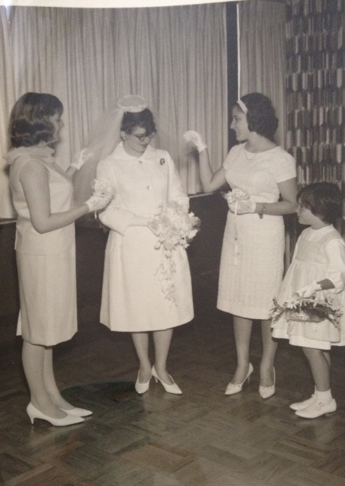 "This is from my mom's wedding. The other women are my aunts (my dad's sisters). My mom's dress was a fab white cocktail dress with a v-back and a bow. The wedding was at an Orthodox shul, hence the coat. I've been playing with an app called Shoebox that uses your phone to ""scan"" and crop physical pictures easily; it works pretty well. This is my 5,000th post."