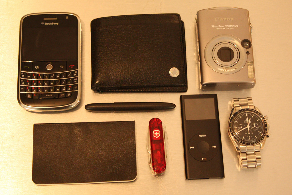 EDC By: N2009F BlackBerry Bold 9000 - Purchase on Amazon Coach Wallet - Purchase on Amazon Canon SD800IS - Purchase on Amazon Moleskine Volant - Purchase on Amazon Fisher Space Pen - Purchase on Amazon Swiss Army Pocket Knife - Purchase on Amazon iPod Nano - Purchase on Amazon Omega Speedmaster Moon Watch - Purchase on Amazon